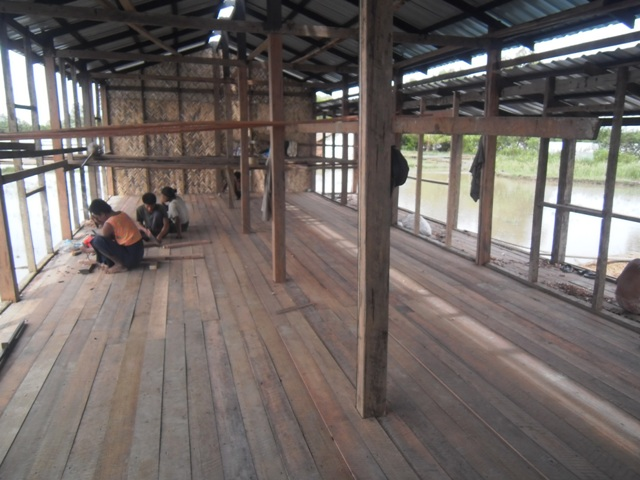 Construction workers building a new school in Burma