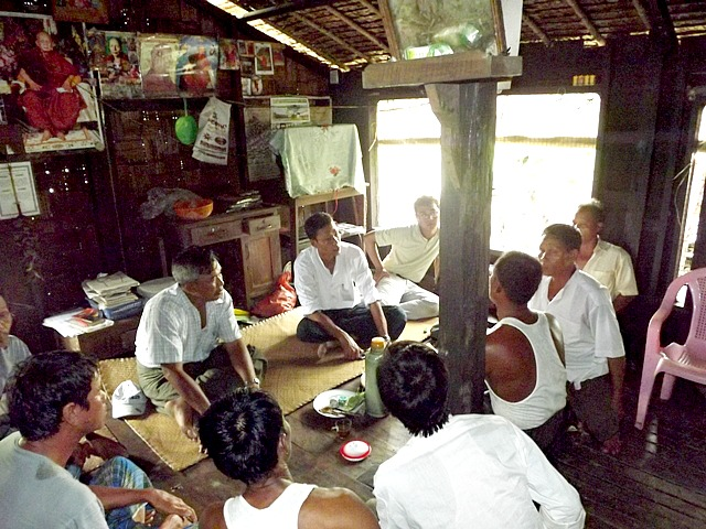 A group of villagers meeting to discuss building a school in Burma